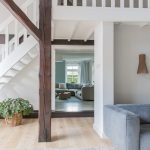 Maja's eikenhouten vloer met karpet